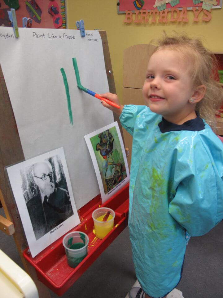 preschooler painting at daycare