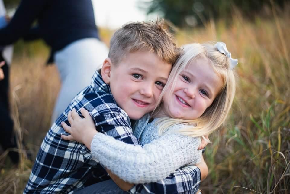 Boy and girl siblings hugging