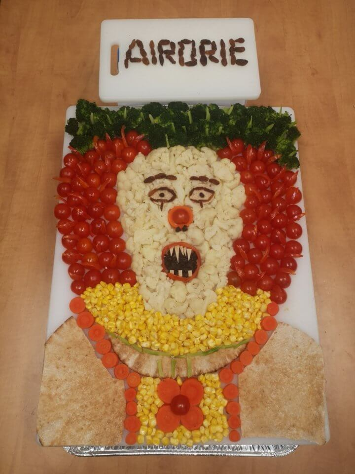 Clown made out of pita, tomatoes, broccoli, corn