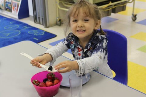 eating berries at Bloor Christie childcare centre