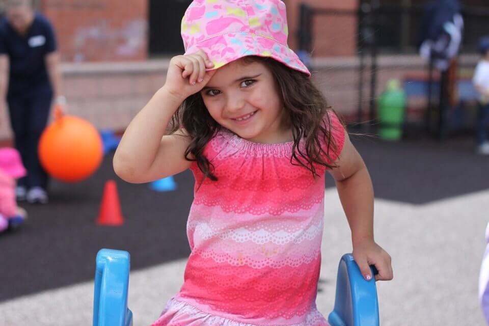child holding hat