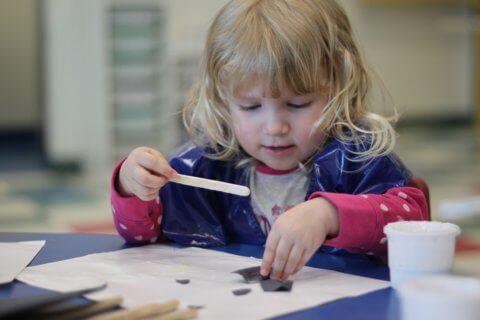 Preschooler doing arts and crafts