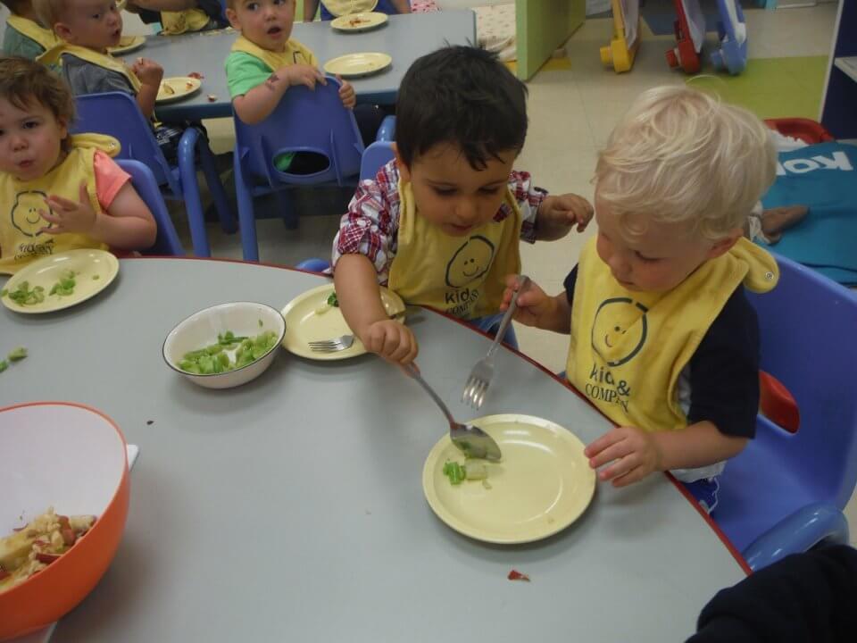 child serving food