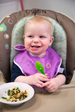 toddler eating lunch at daycare