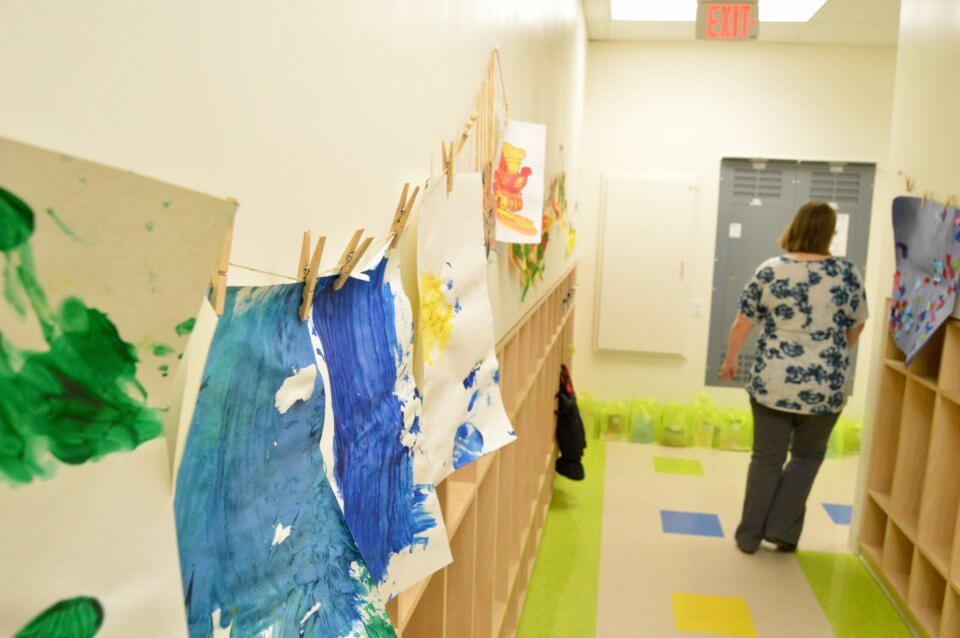 Hallway with paintings at Red Deer Daycare