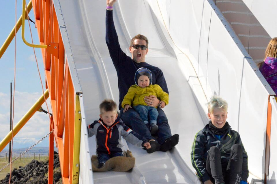 child and parent on slide