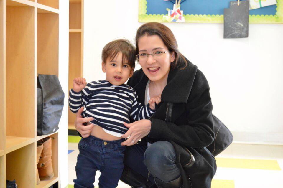 Britannia Crossing Kids & Company ECE with child
