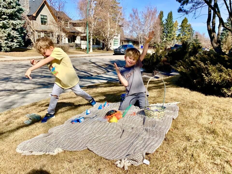 Two children having a picnic outside