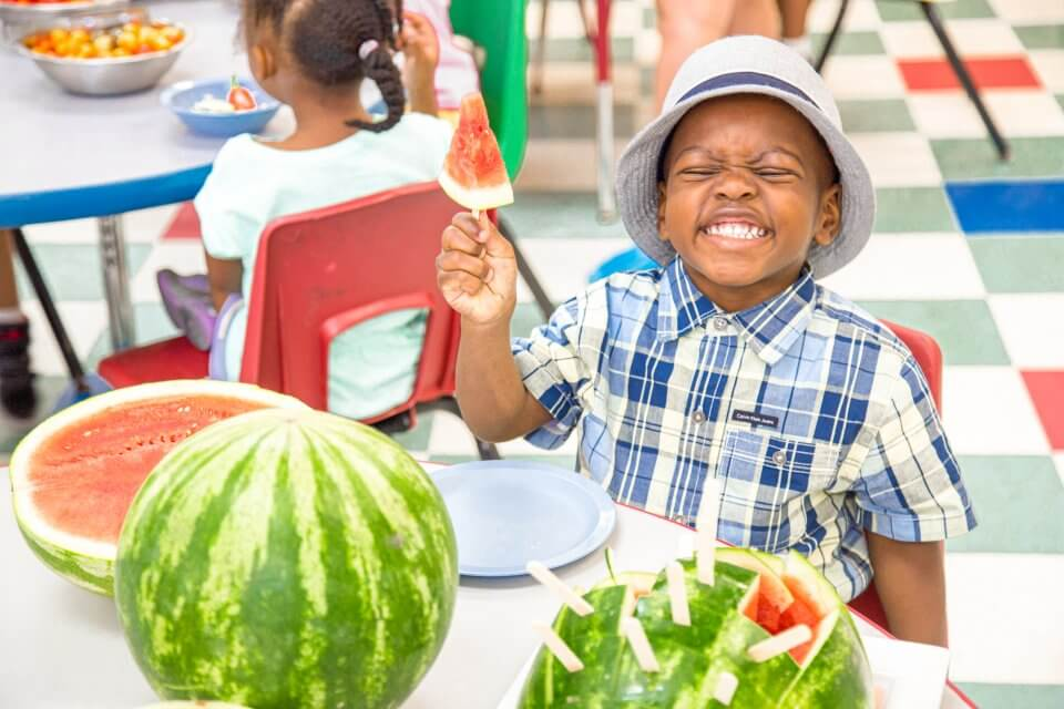 Child eating watermelon at child care centre