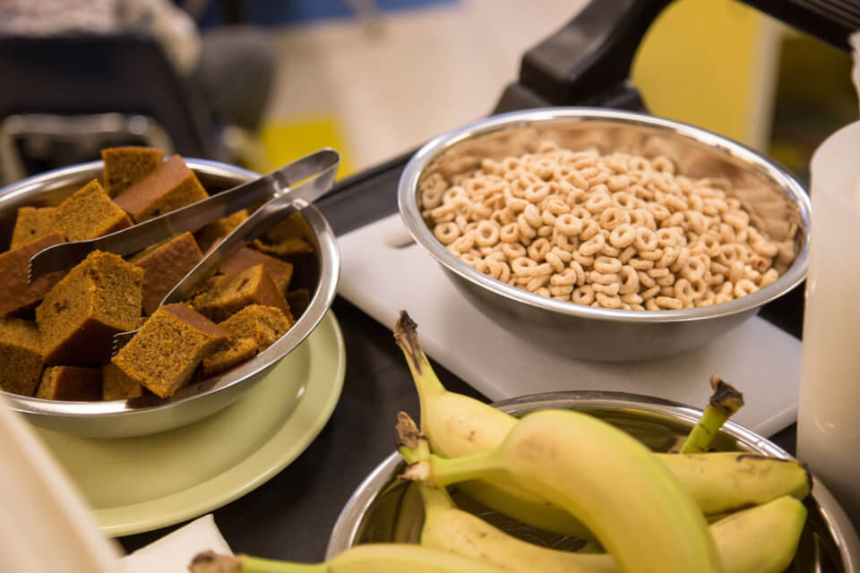cheerios bananas and bread in bowls for kids at daycare