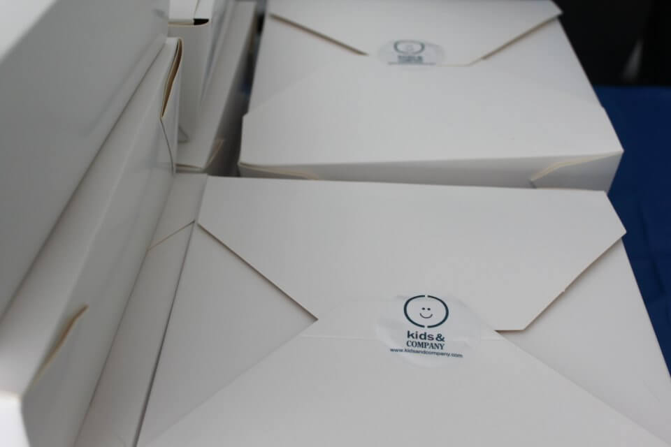 kids and company takeout boxes