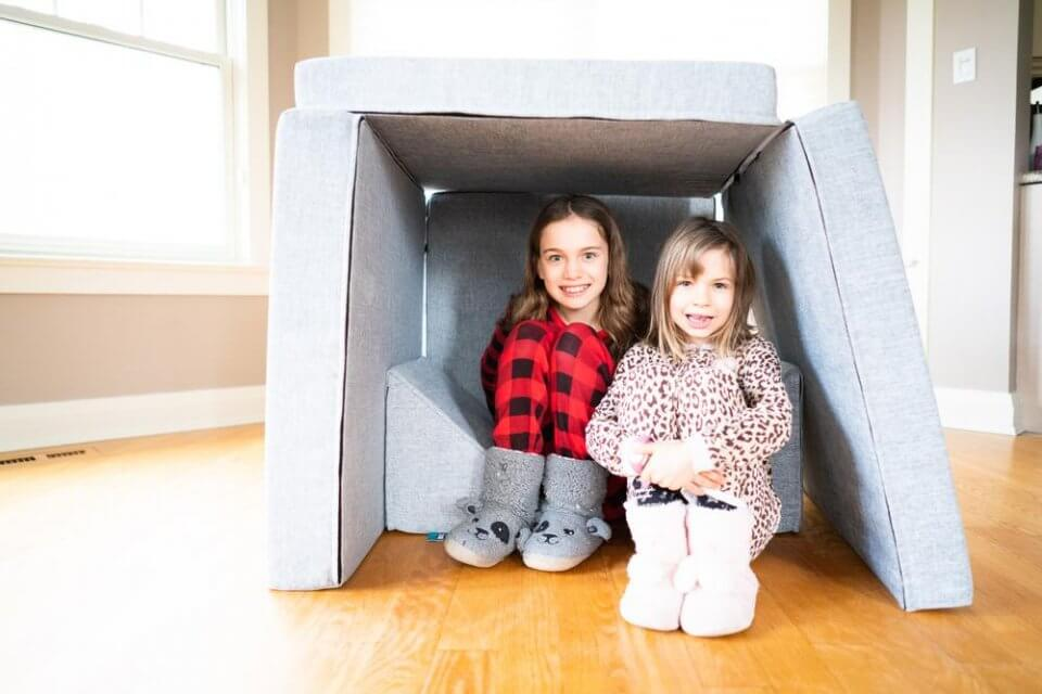 My puffin play couch - two children playing under a play couch