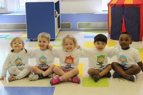 Preschoolers wearing munchkinetics tshirts
