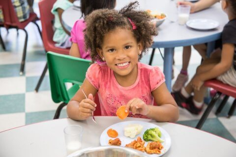Child eating Kidco Kitchen healthy lunch