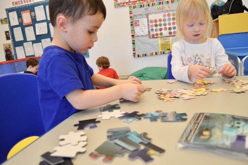 children solving puzzles at canadian daycare