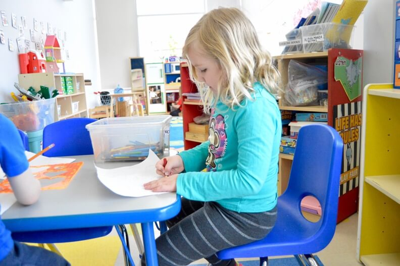 Child colouring at daycare in Canada