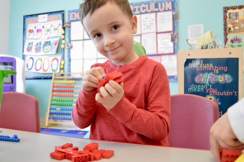 child playing with legos at daycare