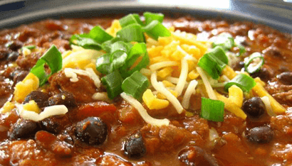 Chili with beans, cheese, and onions