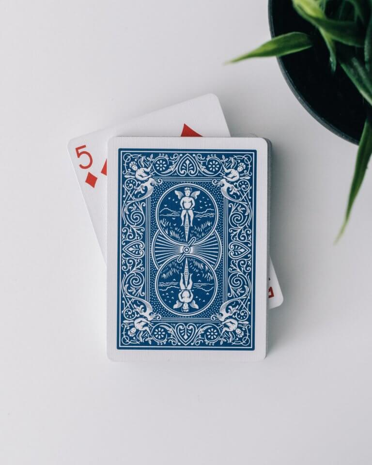 A blue deck of cards showing the 5 of diamonds