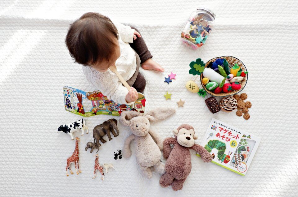 Birds eye image of a child playing with toys.