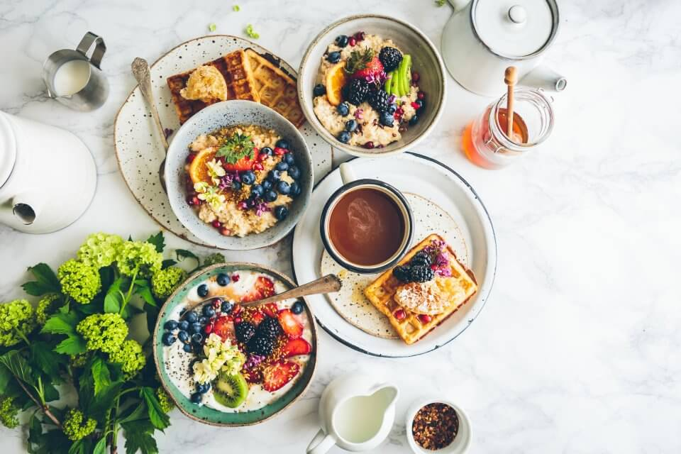 Sunday brunch with waffles, oats and fruit