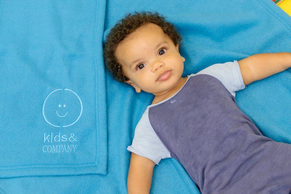 Baby boy on a blue blanket, blue shirt