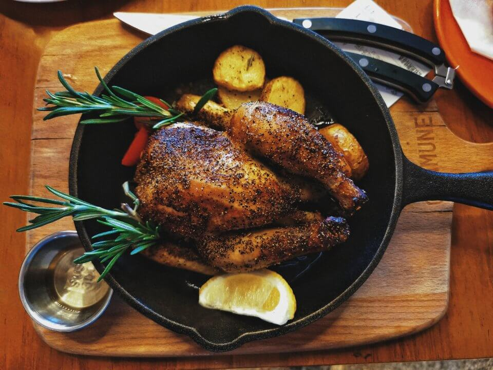 chicken on pan with lemon