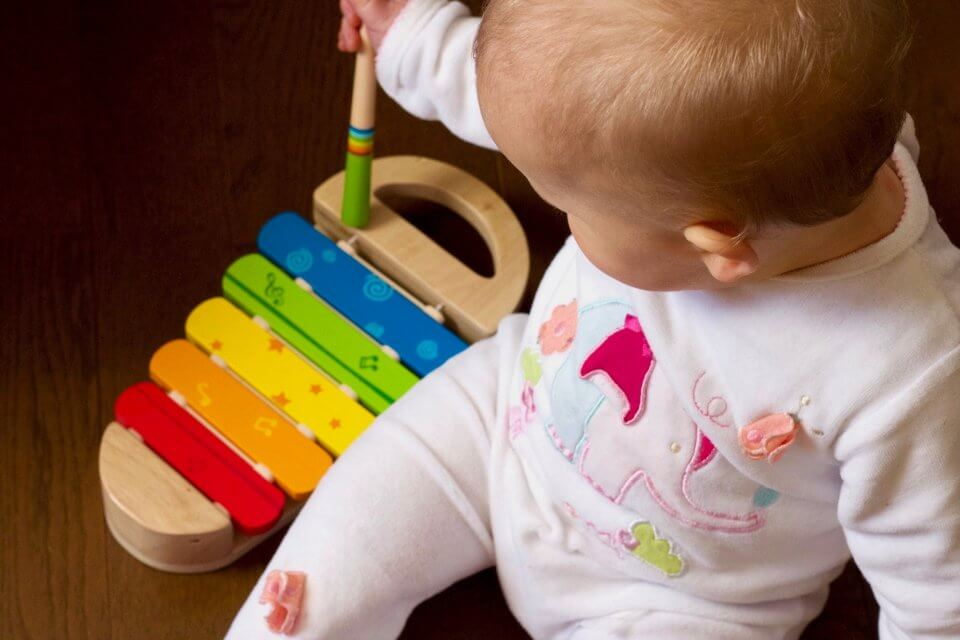 Child playing a musical instrument