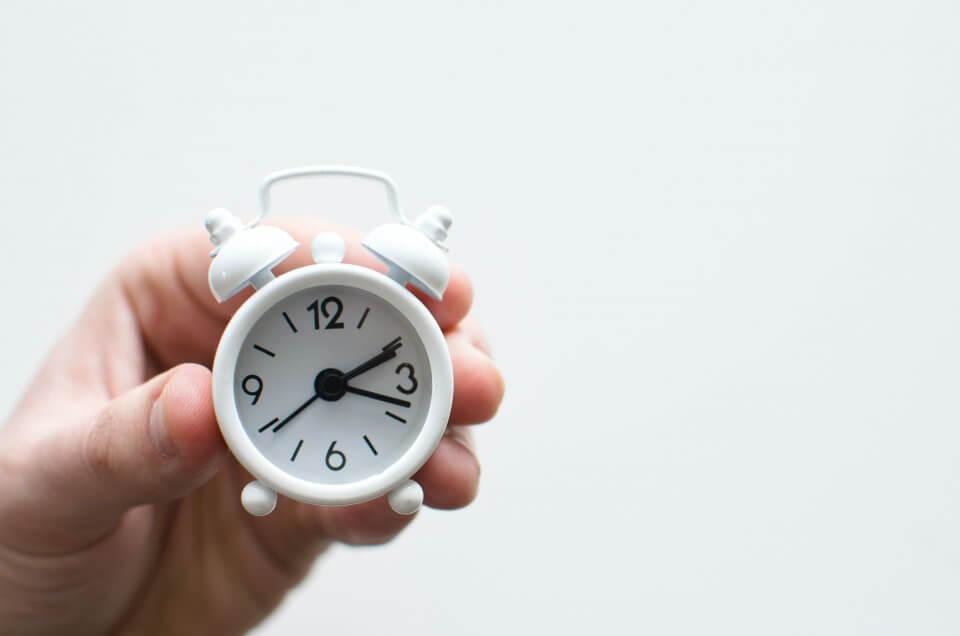 mini white clock on a white background