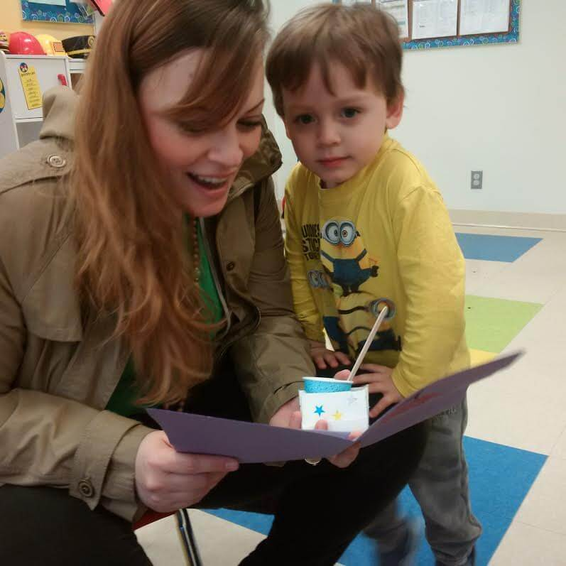 toddler reading card at daycare