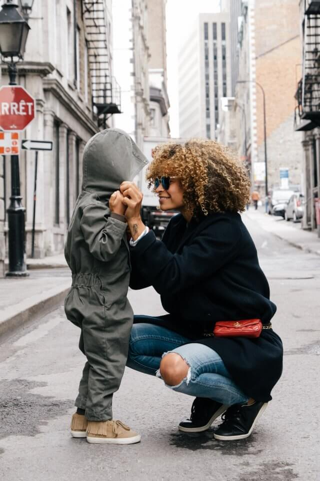 Mother and son together on the street