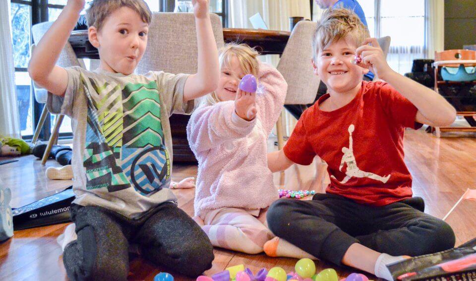 Three children celebrating easter in quarantine