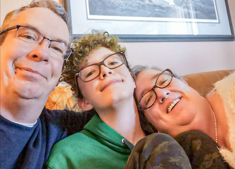 Image of family of three
