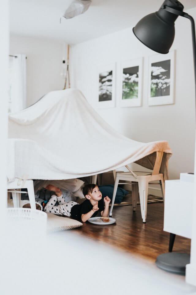 Child building a fort together