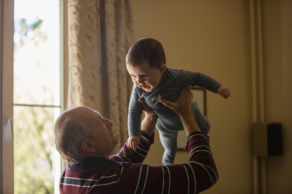Grandpa with his grandson in the air
