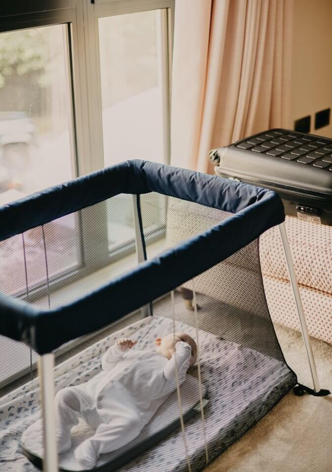 Child napping in a crib