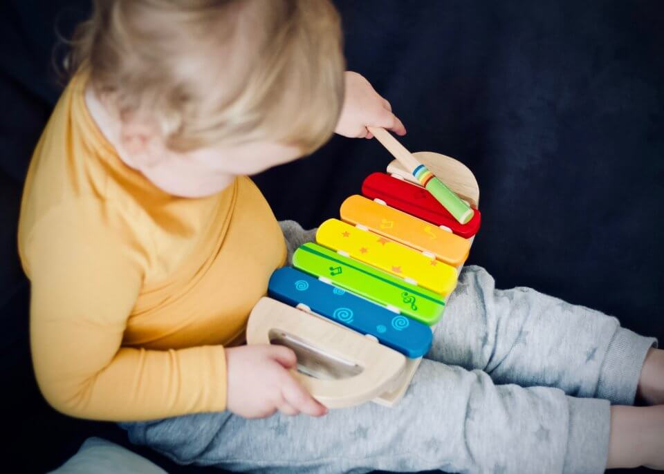 Child playing with a music toy.