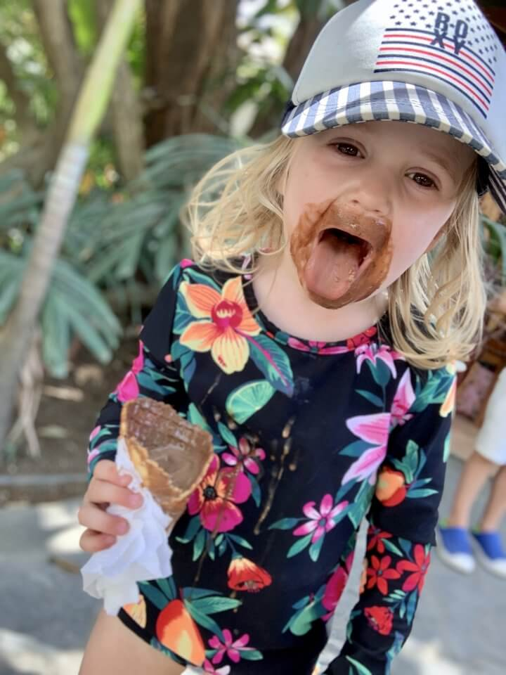 Child with icecream, tongue out!