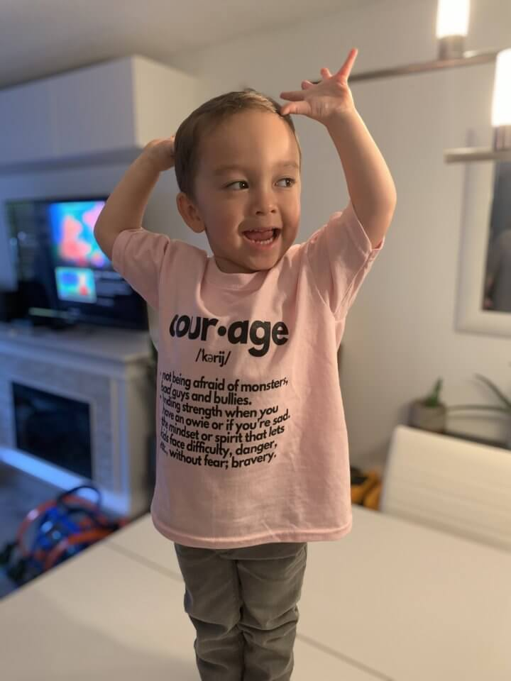 """Jaxsen from BC wearing a shirt with the word """"courage"""" on it to support anti-bullying."""