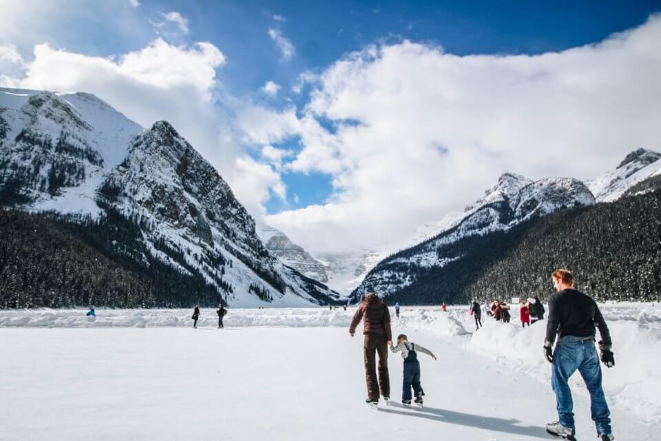 Skating on the lake with family, mountains in the background